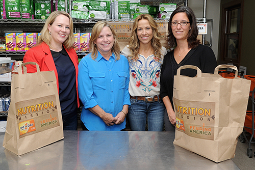 NEW YORK, NY - SEPTEMBER 12: Leah Ray Vice President of Corporate Partnerships,Feeding America, Jeane Larkins, Sheryl Crow and Amy Cappello, Bayer, Brand Director attend the One A Day Women's Nutrition Mission Grant Competition Winner At NYC Food Pantry on September 12, 2013 in New York City.  (Photo by Jamie McCarthy/Getty Images for Bayer HealthCare)