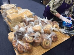 bagels and bread being prepared to serve hungry kids in denver